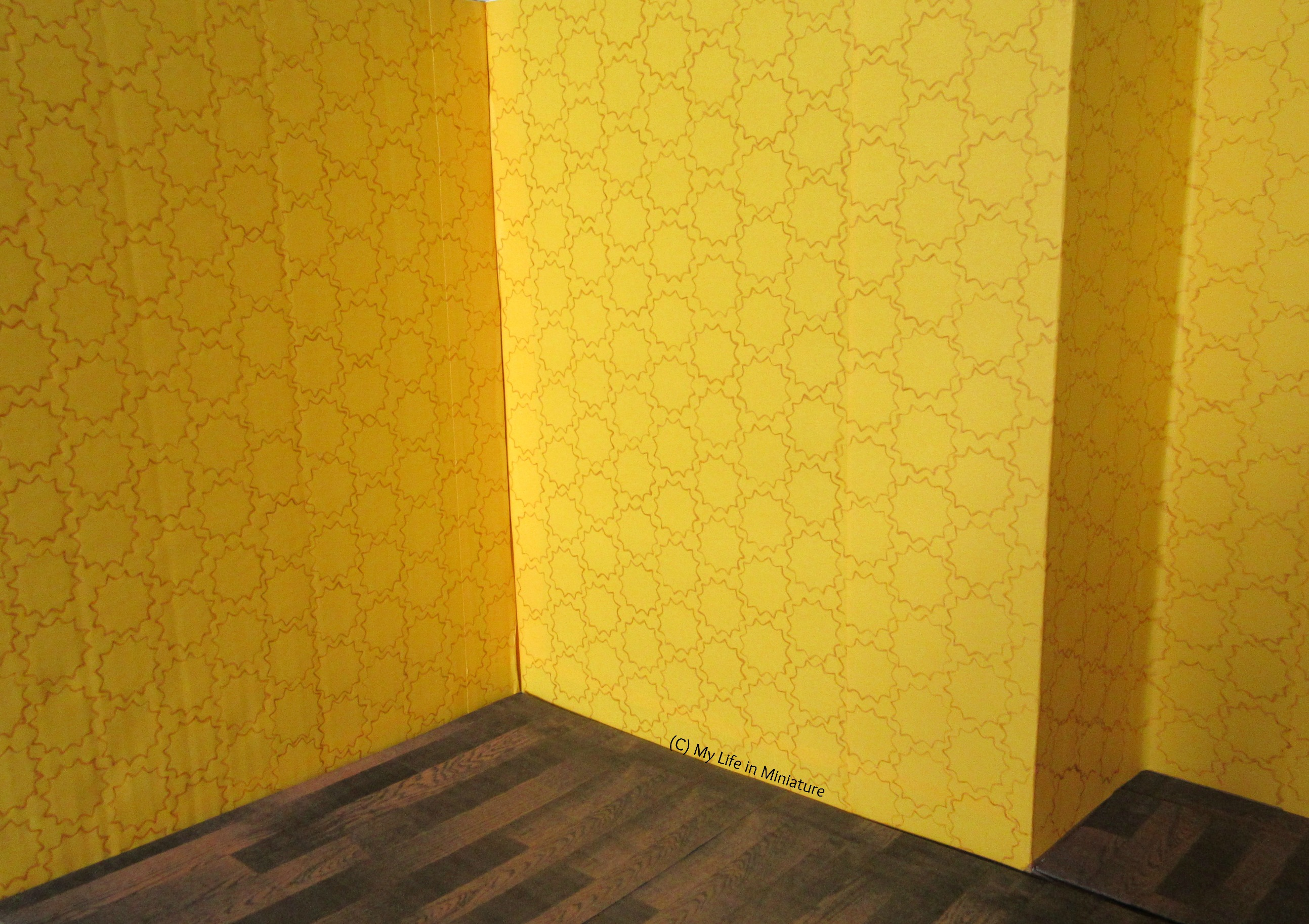 Shot of the interior of the store, yellow walls completely covered in stencilling.