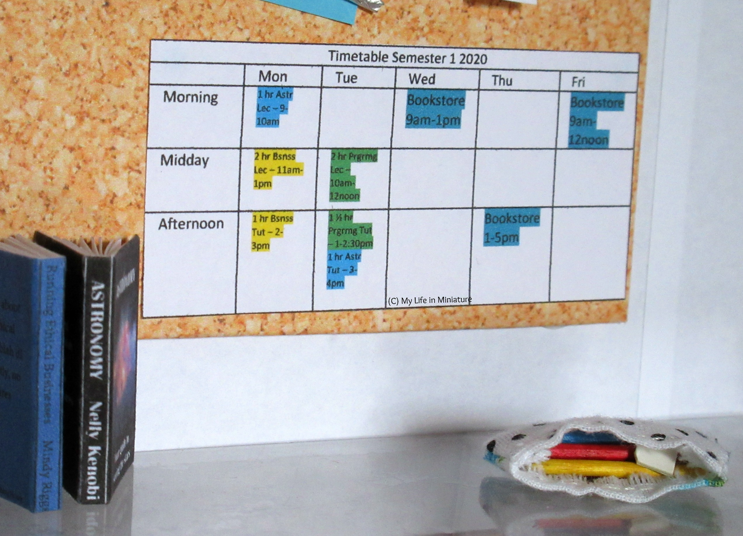 A close-up of Sarah's noticeboard above her desk. A timetable of classes and work shifts is visible.
