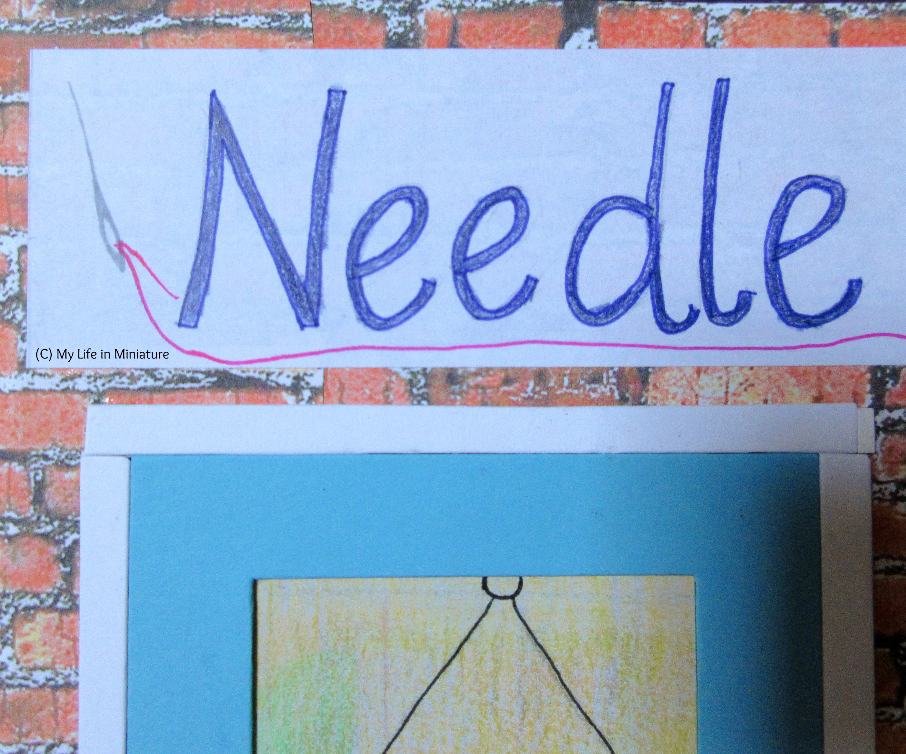 Close-up of the 'Needle' part of Needle & Thread's sign. a silver needle is visible, threaded with neon pink thread.