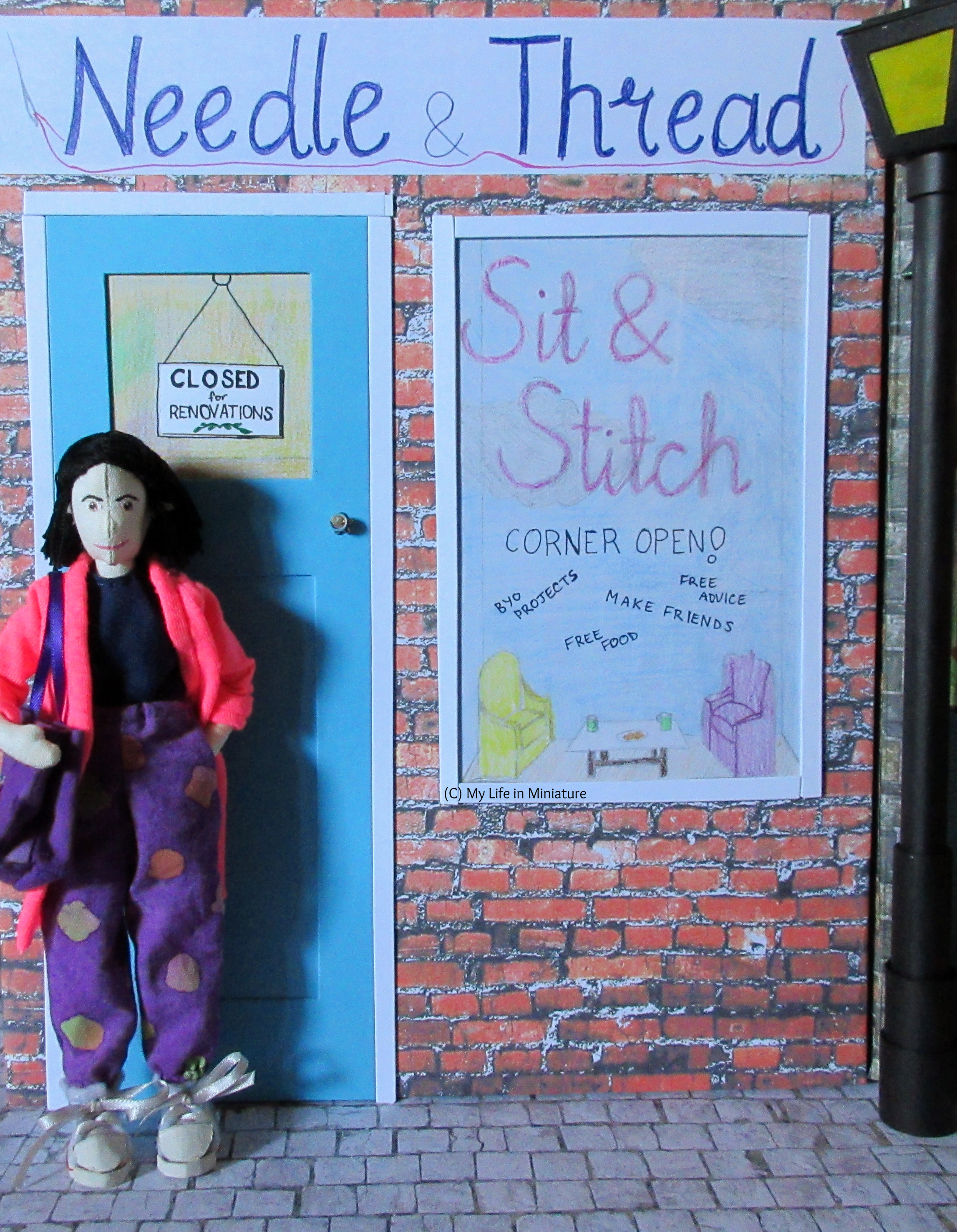 Tiffany stands in front of the blue door of Needle & Thread's front façade. She has a purple tote bag on her shoulder, and a hand in her pocket.