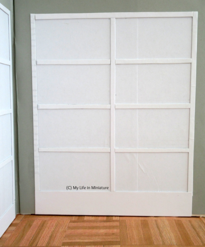 Image shows the right-hand cabinet from the previous image. It is white and has eight rectangular shelves.