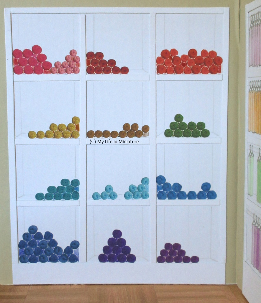 Full view of Needle & Thread's yarn shelves. Yarn is arranged in rainbow order from top left to bottom right on the shelves.