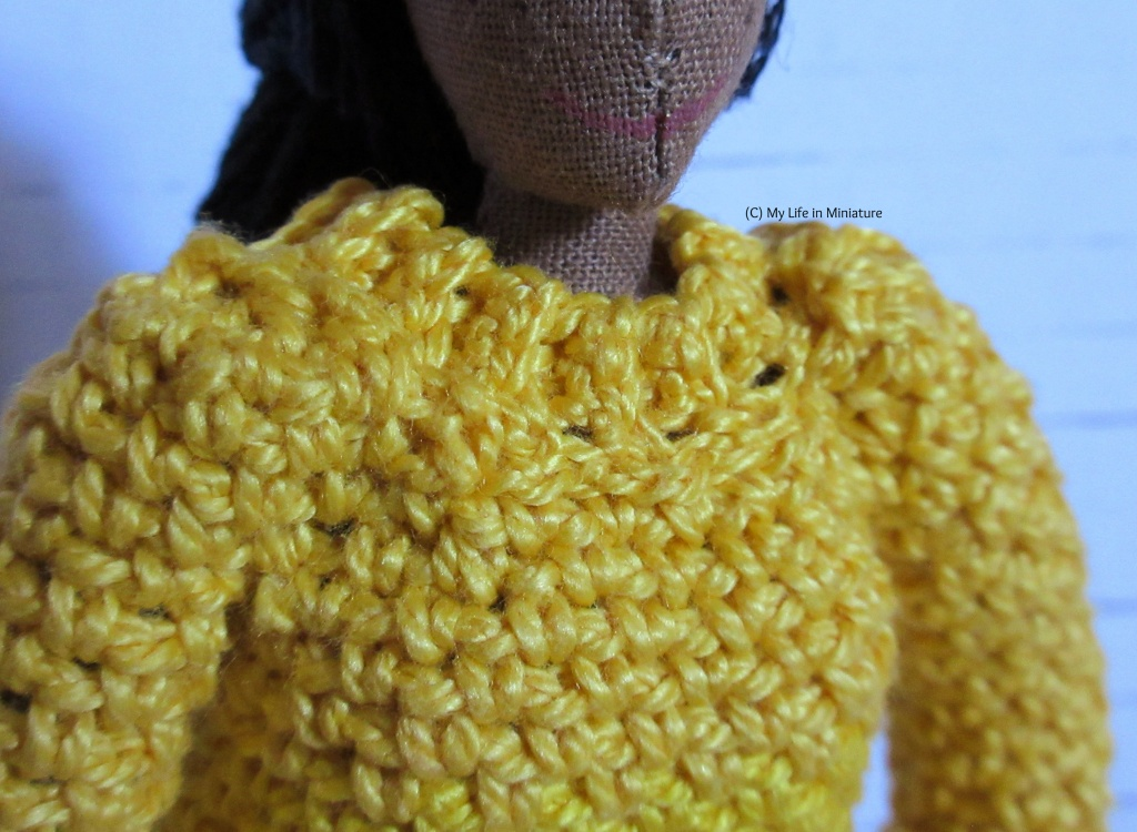 Close-up of the ribbed neckline and shoulders of the jumper.