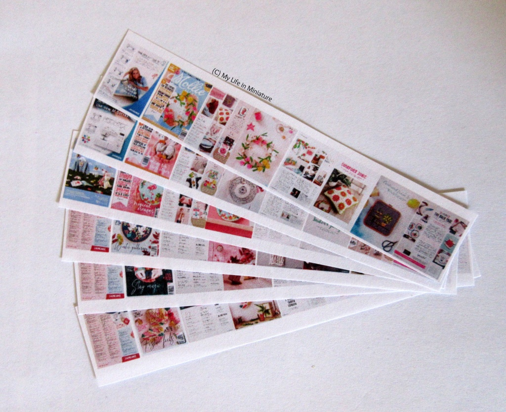 Overhead shot of six strips of paper fanned out on a white background. Each strip has the front and back cover of a magazine, and six inside pages, laid out in a line.